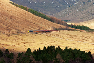 The train is now clear of the Horse Shoe Curve and follows the line along the lower flank of Beinn Dorain towards Bridge of Orchy.