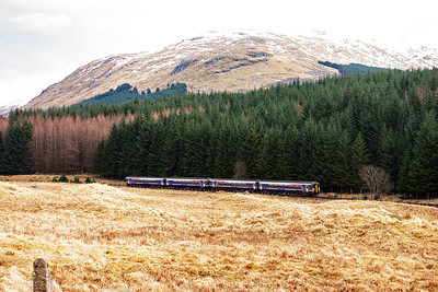Glen Falloch just south of Crianlarich is the location for a one off working. Meanwhile the regular traffic goes on as normal. A pair of class 156 sprinter units head south with 1Y24 1211 Oban to Glasgow Queen Street.