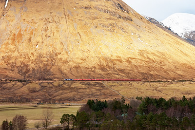 There is no snow at the lower levels as 66728 heads on to Bridge of Orchy for its next token stop.