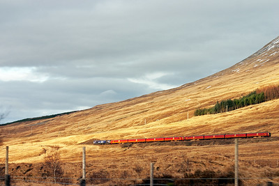 The sun is just hanging in as 66728 plies on westwards to Bridge of Orchy.