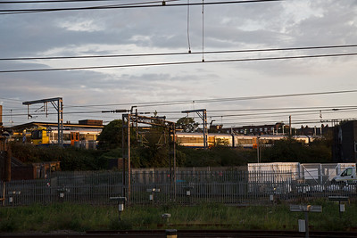 Early morning in west London and the view from the support coach is keeping me sharp with my camera.  London Overground unit 378231 runs into Willesden Junction High Level station with 2N07 0620 off Stratford to Richmond.