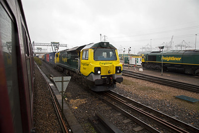 The tour passes by and I record 70007 at the head of 4O15 0721 Lawley Street to Southampton Maritime Freightliner.  To the right is low emission 66954.
