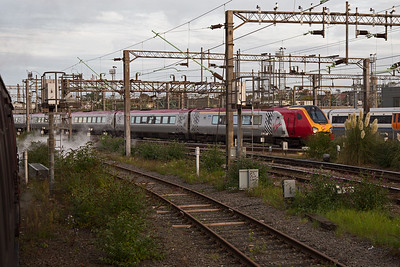 An early morning Virgin West Coast service speeds past Willesden depot with class 221 Super Voyagers 221105 and 221106 running as 1D81 0710 from London  Euston to Chester.  My train was being was being taken from Southall shed to Victoria station diesel hauled with A4 60009 on the back.