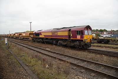66023 has also lost its EWS logos and gained DB ones.  It stands in the yard at Eastleigh with a rake of autoballaster hoppers.