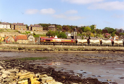 66123 catches the glint as it passes in front of the picturesque village of Culross. The train is 6G45 1038 Millerhill to Longannet Enterprise. I am sitting on the remains of the coal loading jetty at Culross.