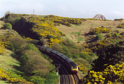 "Turning round to look to the south and the end of North Queensferry tunnel is visible. A Virgin Cross Country high speed set leaves the tunnel with 1S85 0720 off Plymouth to Aberdeen, ""The Devon Scot"". Note how the tunnel was originally a cutting."