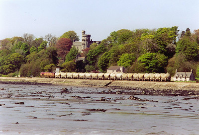 As the train continues along the shore, it passes below Dunimarle Castle. The flyash will go south to Westbury to be made into cement. The tide was coming in and I had to leave the jetty within an hour of taking this shot.