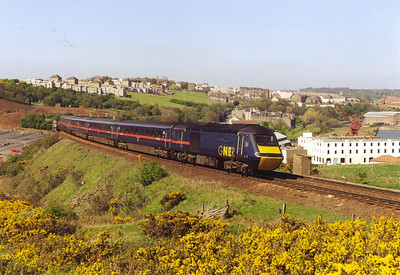 """The deep blue of the GNER livery is lit by the warm May sunlight. 43108 is the rear powercar of 1S20 1030 off Kings Cross to Aberdeen, """"The Northern Lights"""". The train is running about 30 minutes down."""