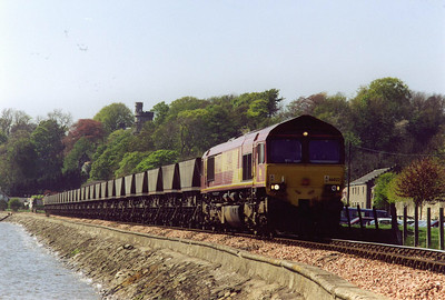 The waters of the River Forth lap gently against the stone embankment of the railway here at Culross (pronounced Cooriss). 66022 approaches at the line speed of 15mph.