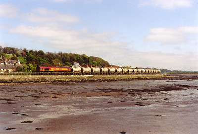 Three shots of the same train but three different pictures. 66123 comes along the foreshore with a rake of 20 empty PCA tanks for loading with fly ash at Longannet Power Station.