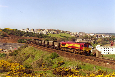 A final view of 66022 as it climbs the 1 in 70 grade to gain the height needed to reach and cross the River Forth by means of the Forth Bridge.