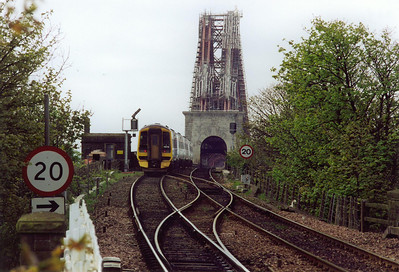 Looking south from the south end of the up platform at North Queensferry and 158740 and 158731 pass over the change of gradient from 1 in 70 climbing to the level of the Forth Bridge.  The pair form 1B07 0759 Markinch to Edinburgh.