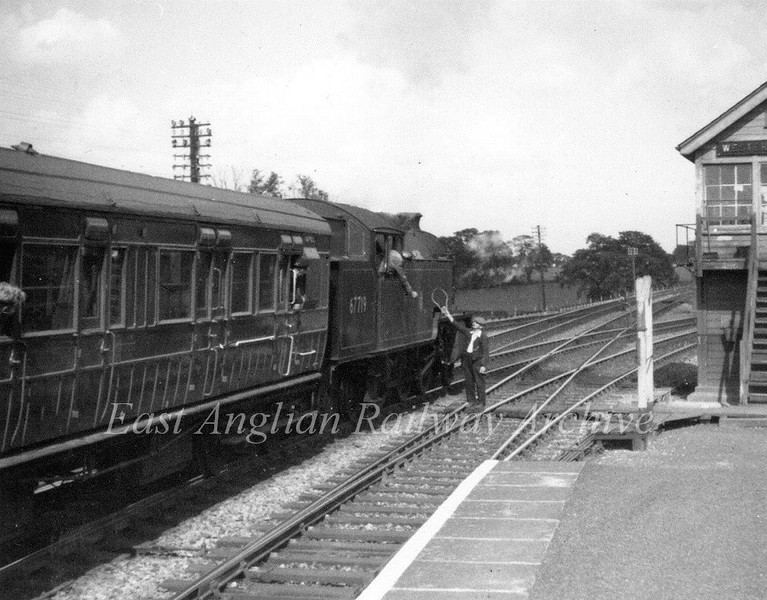 Taking the token for the Derby Road section at Westerfield Junction with Class L1 No. 67719. Loco introduced 1945. Photo Brian Leighton.