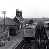 Trimley viewed towards Felixstowe on 29th May 1977 viewed from the footbridge. The signal box is hidden behind the canopy on the up platform. Today only the down platform is in use. Trimley lost its freight facilities on 13th July 1964.