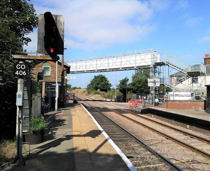 Westerfield on 2nd July 2019. A temporary footbridge has been erected  by Network Rail for pedestrian access. The B1077 road has been closed for engineering work on the barriers.