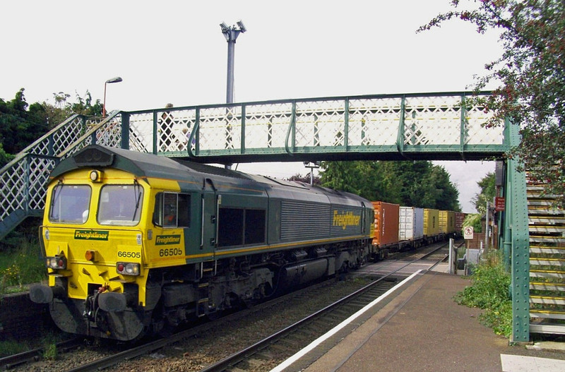 Framed by the footbridge 66505 heads a Felixstowe bound Freightliner through Trimley on 13th September 2010.