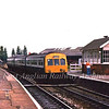 Driver of a class 101 on a Felixstowe to Ipswich working drops off the single line token at Derby Road for the Trimley to Derby Road section. c1995  The aerial on the front of the dmu indicates that this unit was used on the East Suffolk Line utilising Radio Electonic Token Block, RETB, signalling. This poor quality image taken with a disposable camera.
