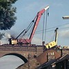 On 5th October 1975, at Spring Road Viaduct, work was taking place to excavate the track bed, to insert concrete strengthening. The image shows a crane which appears to have become derailed. A 75 ton steam crane is assisting.<br /> <br /> image with kind permission of John Strutt.