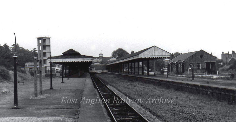 Felixstowe Town Station on 16th September 1976. The area of the goods shed to the right is now a Solar Superstore and the current station has been moved towards the foreground. The area where the dmu stands is now a car park. Felixstowe Town Fire Station's drill tower can be seen on the left. The town station lost its freight facilities on 5th December 1966.