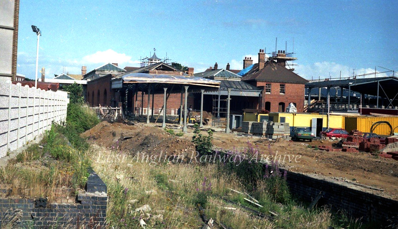 Removing the station canopies and platforms at Felixstowe for conversion to a car park area. A Solar Superstore is under construction to the extreme right. 2nd August 1984.<br /> <br /> Image with kind permission of Stuart McNae