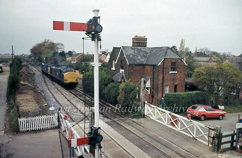 Trimley facing Westerfield on 4th November 1986. Station still has manual gates and semaphores. Note the shortened lower arm to clear the footbridge.<br /> <br /> Image with kind permission of Stuart McNae