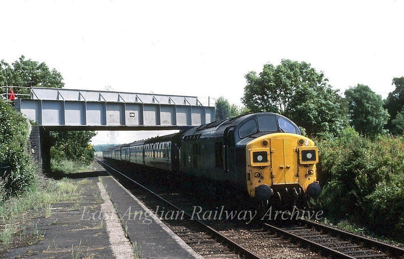 Unknown Class 37 passes Wickham Market on a Lowestoft to Liverpool Street working in the summer of 1981.