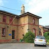 The road approach to Bealings recorded on 7th June 2021. The goods shed had been adapted and extended  to enlarge the Mallard House Business Centre.  The station building is of Eastern Union Railway design, similar to Woodbridge.