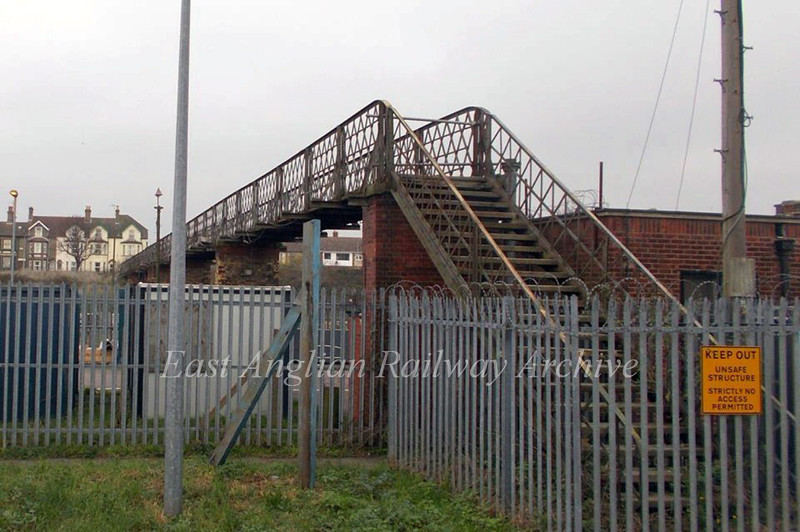"The ""Iron bridge"" carried a footpath over the railway from Denmark Road to Commercial Road, pictured on 29th November 2014, a few weeks away from demolition by Network Rail. The bridge was closed to pedestrian traffic in May 2005 being deemed unsafe. The view is from Commercial Road,  with the houses in Denmark Road in the background. Photo with kind permission of Ashley Gardiner.  The previous two photos were taken from this bridge."