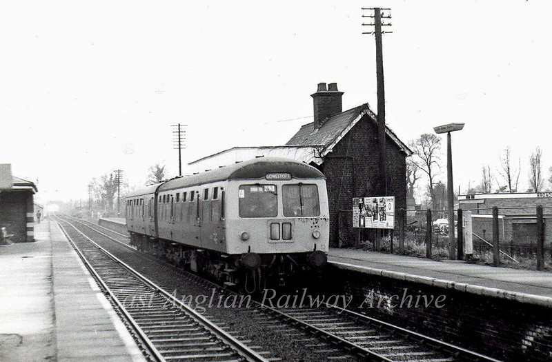 Cravens Class 105 two car unit forms the 1048 Ipswich to Lowestoft on 10th January 1976. The down platform is no longer in use, the building used as a hairdresses. The line is now singled at this point.