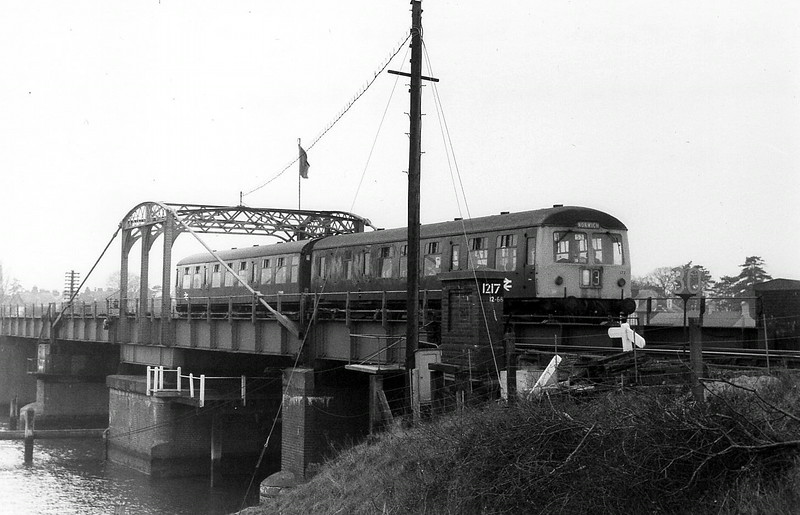 The 1048 Ipswich to Lowestoft crosses Oulton Broad Swing Bridge on 16th February 1976.