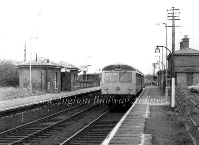 The 1248 Ipswich to Lowestoft arrives at Darsham on 30th March 1976. At this time the station lamps were being replaced. The old lamps from the fifities stand alongside  the new ones.  See next photo.