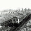 In a pleasant rural setting the 1155 Lowestoft to Ipswich has just left Oulton Broad South on 20th February 1976.