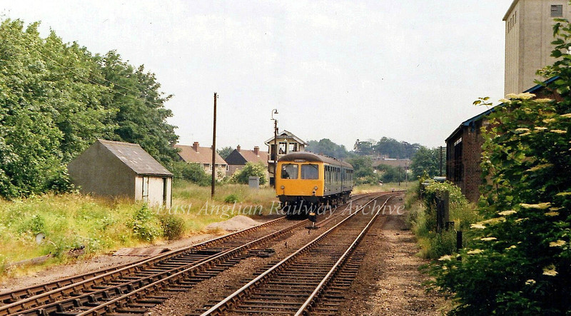The 1450 Lowestoft to Ipswich passes the Beccles South Signal Box.  28th June 1979.
