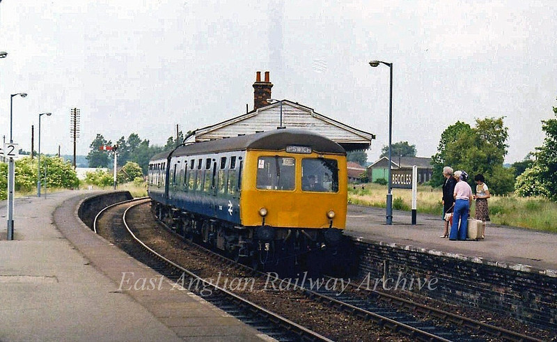 The 1450 Lowestoft to Ipswich stands at Beccles on the 28th June 1979. The station still has blue BR Eastern Region running in boards. The redundant engine shed can be seen behind the sign.