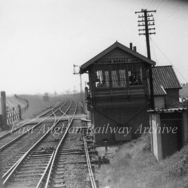 Wickham Market Junction Signal Box on the East Suffolk Line.c1965. This was the junction for the Framlingham Branch. Behind the box is Blackstock Crossing. Photo Brian Leighton.