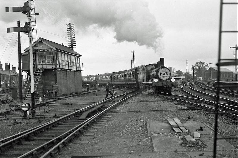 Beccles facing north towards Yarmouth and Lowestoft. The North Junction box is to the left. An M and GN Special is just leaving the Waveney Valley Line probably about the time of the lines closure. The engine shed is to the right. Image:- J S Doubleday.
