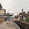 Saxmundham looking South on 28th June1979. Station still has manual crossing gates and semaphore signals.