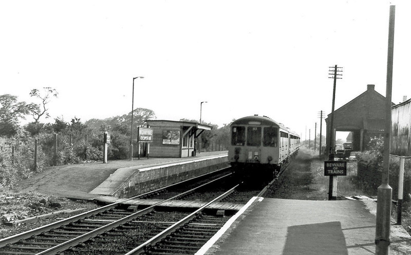 Wickham Market showing the now abandoned Up platform.  The 1740 Ipswich to Lowestoft is approaching.  18th June 1976
