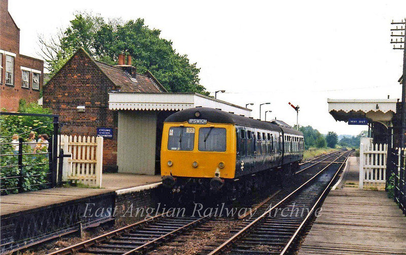 The 1255 Lowestoft to Ipswich stands at Halesworth on 28th June 1979. The buildings on the Up platform have now been demolished.
