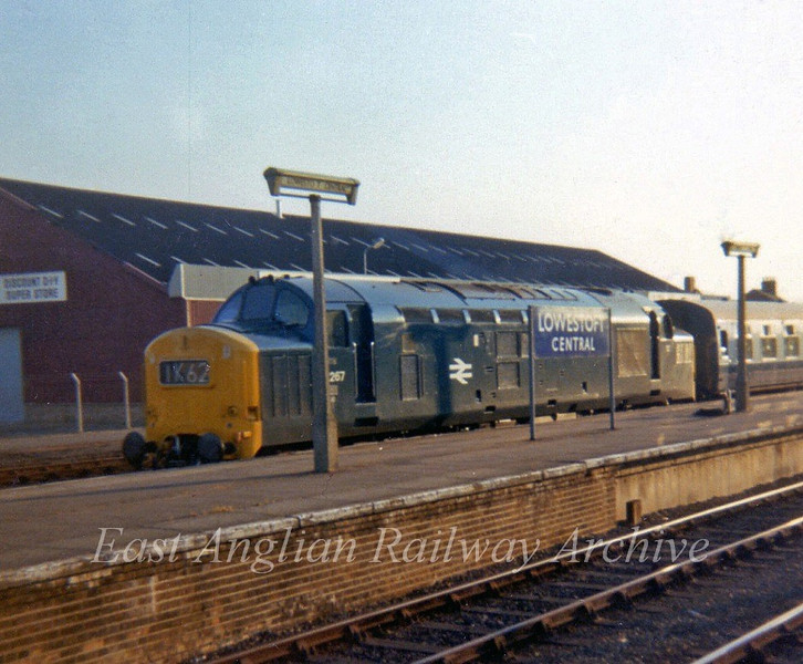 37267 arrives at its destination with 1K62, the 1650 from Liverpool Street. The  blue running in board still showing Lowestoft Central to differenciate it from Lowestoft North.  June 1975. Taken with my trusty Instamatic which is all I had at the time.