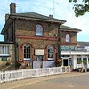 Woodbridge station viewed from the road approach. The building was constructed by the Eastern Union Railway and is of a different design to other stations along the East Suffolk line eg Melton.  I love the interesting round headed sash windows with the red brick surrounds. The station house is home to the Whistle Stop Café , an artisan florist and a taxi company.<br /> <br /> Image dated:- 20th August 2020.