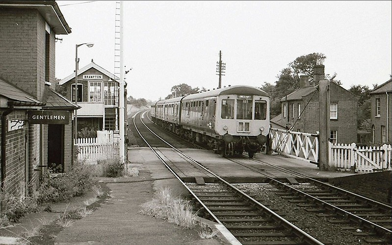 Brampton on 16th July 1976. A Gloucester RCW dmu is arriving on an Ipswich to Lowestoft working. The station house is to the left.<br /> <br /> Image:- Russell Walker.