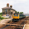 The 1048 Ipswich to Lowestoft pauses at Wickham Market on 28th June 1979. Note the splendid blue BR Eastern Region running in board.