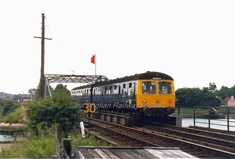 "1448 Ipswich to Lowestoft crosses Oulton Broad Swing Bridge with an incorrect destination blind on  28th June 1979. The ""Lady of the Lake"" pub can be seen to the extreme right."