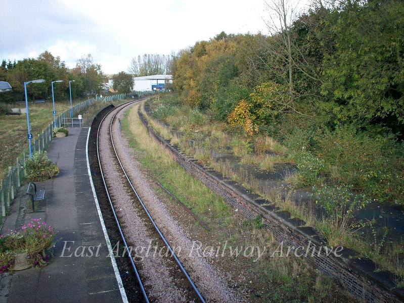 Beccles, view from the footbridge looking towards Oulton Broad showing the abandoned Up platform.  1st October 2008. The up platform has now been reinstated with a passing loop which will allow an hourly service from Ipswich to Lowestoft starting with the December 2012 timetable.