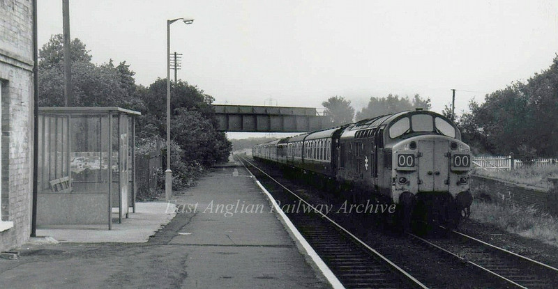 Wickham Market on 18th June 1976. 37014 is passing with the Summer Saturdays only 1040 Lowestoft to Liverpool Street.
