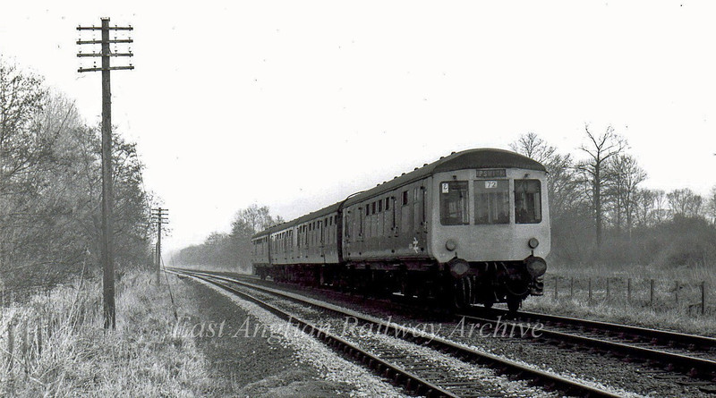 The 1450 Lowestoft to Ipswich passes through the Suffolk countryside at Barnby between Oulton Broad South and Beccles.  20th February 1976.