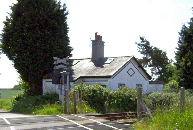 Williw Marsh Crossing Keepers Cottage North of Darsham carries the characteristic diamond design of the East Suffolk Railway. Crossing is now AOB. The crossing was the first on the line to be converted to AOCL ( Automatic Open Crossing Locally Monitored) This was achieved on 21st August 1983.
