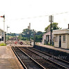 Brampton facing south. The Down platform no longer exists as the line is now single track at this point. The station shelter can be seen at Mangapps Museum, Burnham on Crouch. Image dated 28th June 1979. Brampton lost its freight facilities on 13th July 1964.