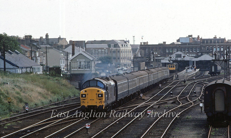 Lowestoft Central on 30th August 1980 with 37088 departing from platform four, in charge of the 1030 Summer Saturdays only to Liverpool Street via the East Suffolk Line. Photo taken with a 200mm lens from the footbridge.